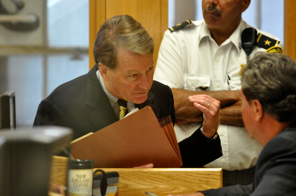 . DIstrict Attorney David F. Capeless Confers with speaks with a David Kearns before the arraignment of  Adam Lee Hall, David Chalue and Cais Veiovis (Roy Gutfinski) on triple murder charges, Mon Sept 12, 2011 (GARVER)