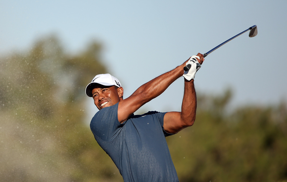 Description of . Tiger Woods of the USA during the second round of the Abu Dhabi HSBC Golf Championship at the Abu Dhabi Golf Club on January 18, 2013 in Abu Dhabi, United Arab Emirates.  (Photo by Ross Kinnaird/Getty Images)