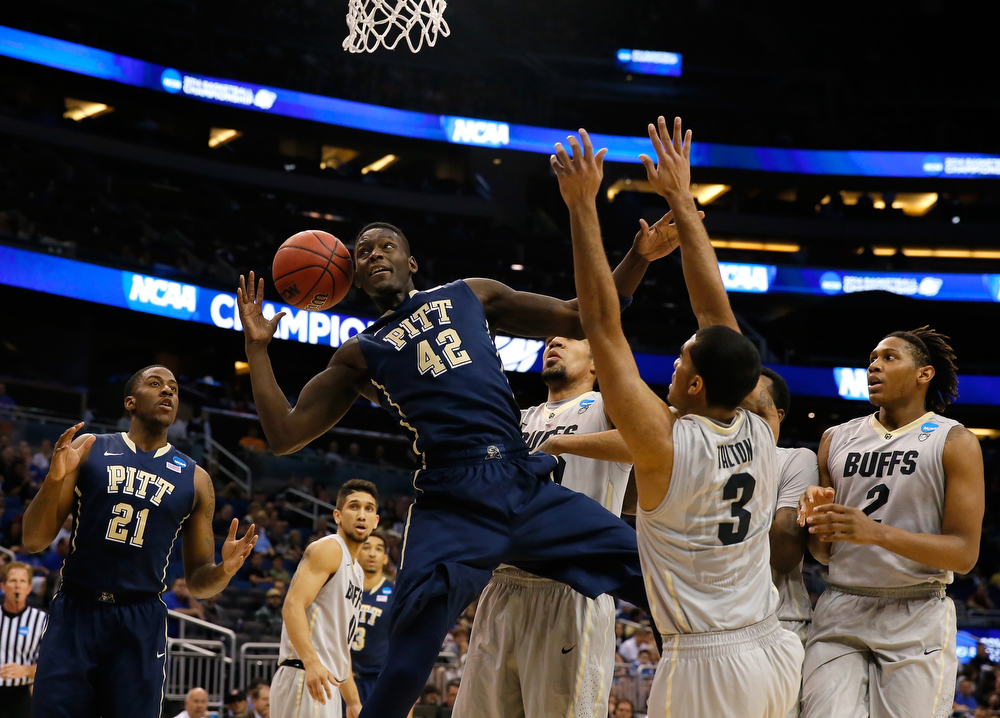 . Talib Zanna #42 of the Pittsburgh Panthers is fouled by Xavier Talton #3 of the Colorado Buffaloes in the first half during the second round of the 2014 NCAA Men\'s Basketball Tournament at Amway Center on March 20, 2014 in Orlando, Florida.  (Photo by Kevin C. Cox/Getty Images)