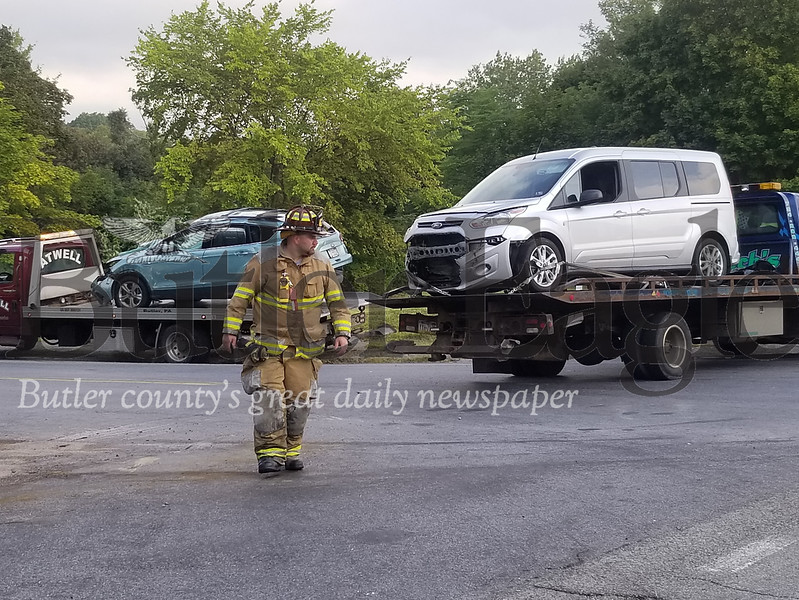 Six people were injured and four otheres transported by helicopter after a three-vehicle crash at the intersection of Airport Road and Route 8. The crash occurred about 7:30 a.m. Wednesday and closed the road in both directions briefly as medical helicopters responded to the scene.Photo by Jim Smith/Butler Eagle