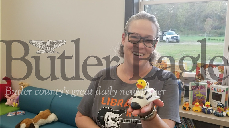 Karen Pierce, director of Slippery Rock Community Library, holds Spaceship duck, which was given to the library by members of the Slippery Rock High School marching band.