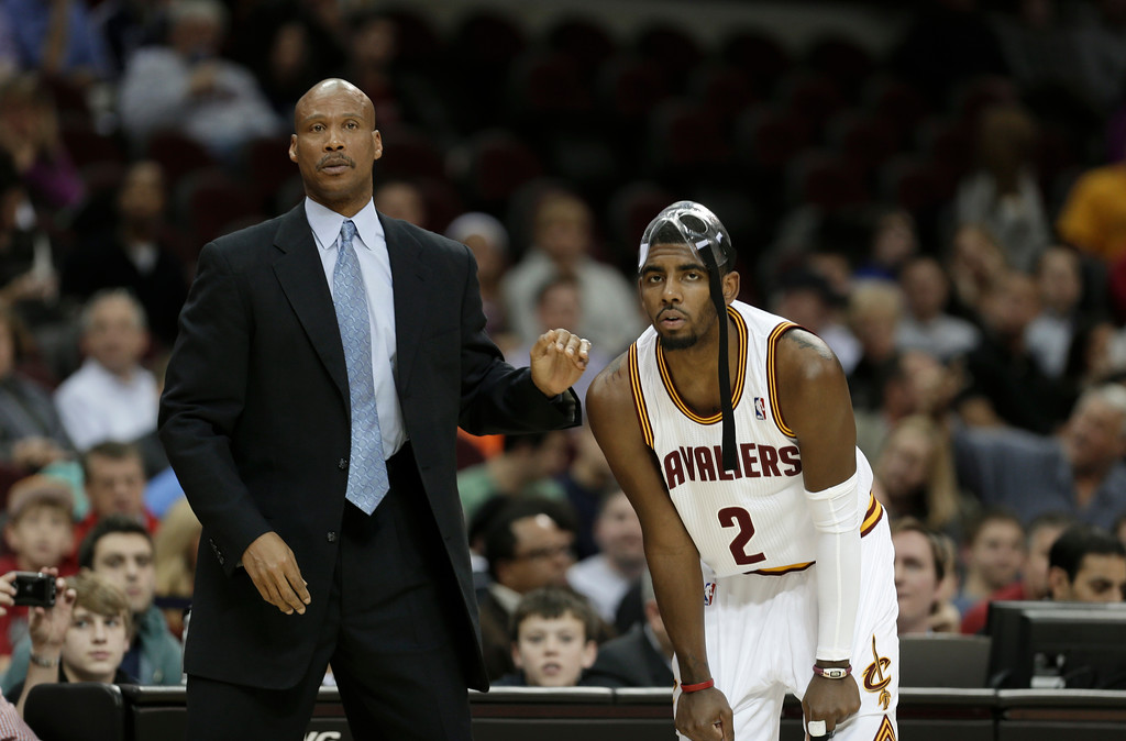 . Cleveland Cavaliers head coach Byron Scott, left, talks with Kyrie Irving during an NBA basketball game against the Indiana Pacers Friday, Dec. 21, 2012, in Cleveland. (AP Photo/Tony Dejak)