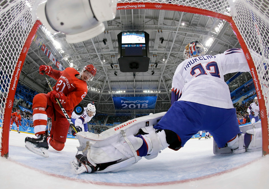 . Russian athlete Sergei Kalinin (21) shoots the puck past goalie Lars Haugen (30), of Norway, for a goal during the second period of the quarterfinal round of the men\'s hockey game at the 2018 Winter Olympics in Gangneung, South Korea, Wednesday, Feb. 21, 2018. (AP Photo/Matt Slocum, Pool)