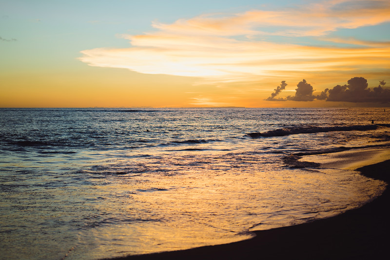 sunset on the ocean. beautiful bright sky, reflection in water, waves.