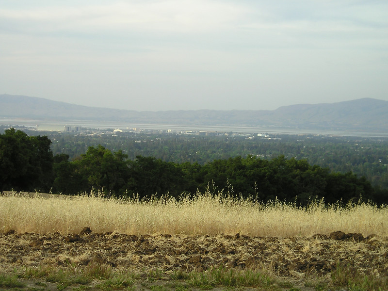 View from the water tower hill, looking across the blimp hangers at Moffet Field on to San Francisco Bay.