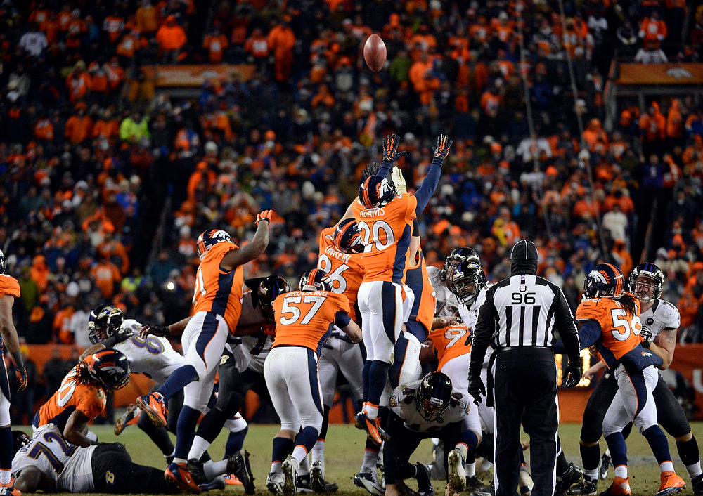 Description of . The winning field goal is kicked in overtime putting the Baltimore Ravens at 38 to the Denver Broncos 35. The Denver Broncos vs Baltimore Ravens AFC Divisional playoff game at Sports Authority Field Saturday January 12, 2013. (Photo by John Leyba,/The Denver Post)