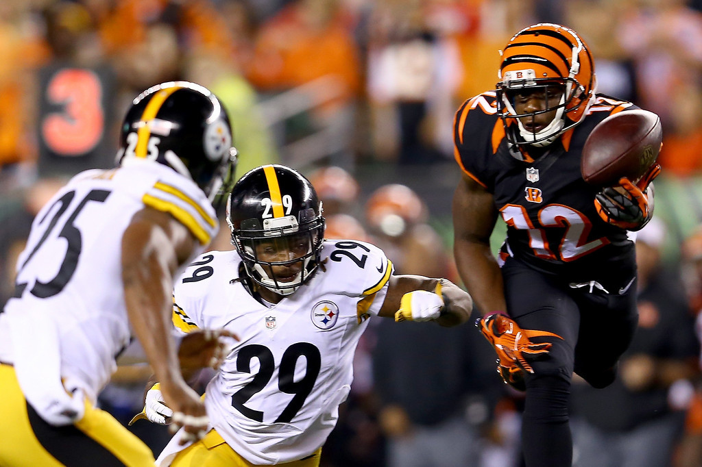 . Wide receiver Mohamed Sanu #12 of the Cincinnati Bengals is unable to make a catch against strong safety Shamarko Thomas #29 and free safety Ryan Clark #25 of the Pittsburgh Steelers in the second quarter at Paul Brown Stadium on September 16, 2013 in Cincinnati, Ohio.  (Photo by Andy Lyons/Getty Images)