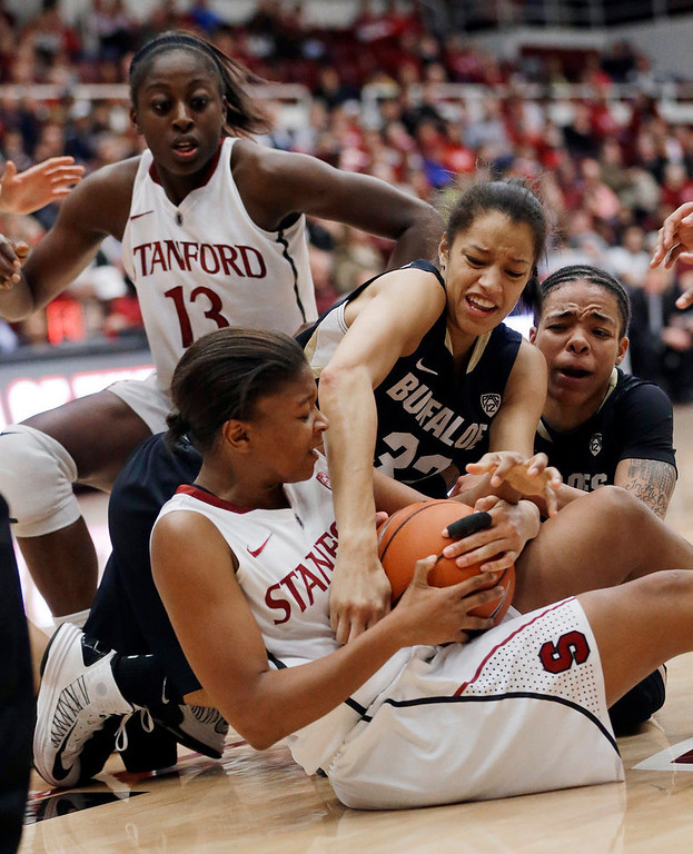 . Stanford\'s Amber Orrange, bottom, scrambles for a loose ball with Colorado\'s Arielle Roberson (32) and Chucky Jeffery, right, as Stanford\'s Chiney Ogwumike (13) watches during the second half of an NCAA college basketball game in Stanford, Calif., Sunday, Jan. 27, 2013. Stanford won 69-56. (AP Photo/Marcio Jose Sanchez)