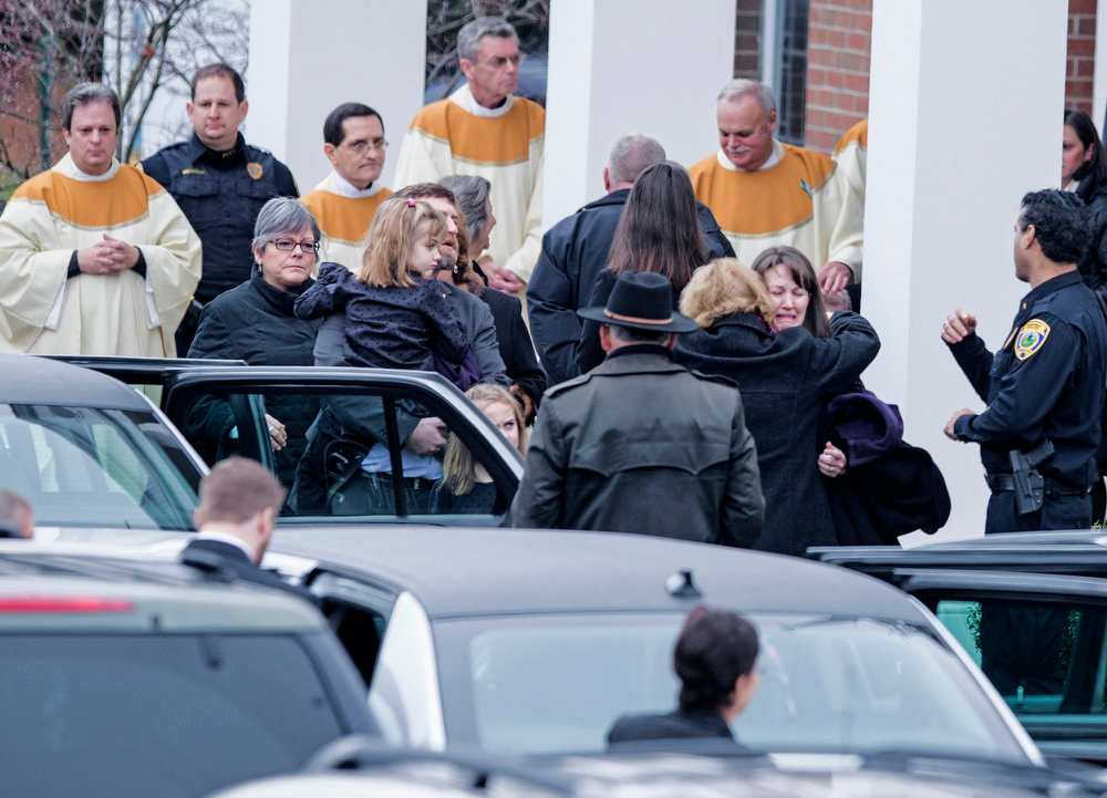 . Loved ones leave after a funeral Mass for James Mattioli outside St. Rose of Lima Roman Catholic Church on December 18, 2012 in Newtown, Connecticut. Mattioli, 6, is one of the victims from last Friday\'s shooting at Sandy Hook Elementary School which took the lives of 20 students and 6 adults.  AFP PHOTO/Brendan SMIALOWSKI/AFP/Getty Images