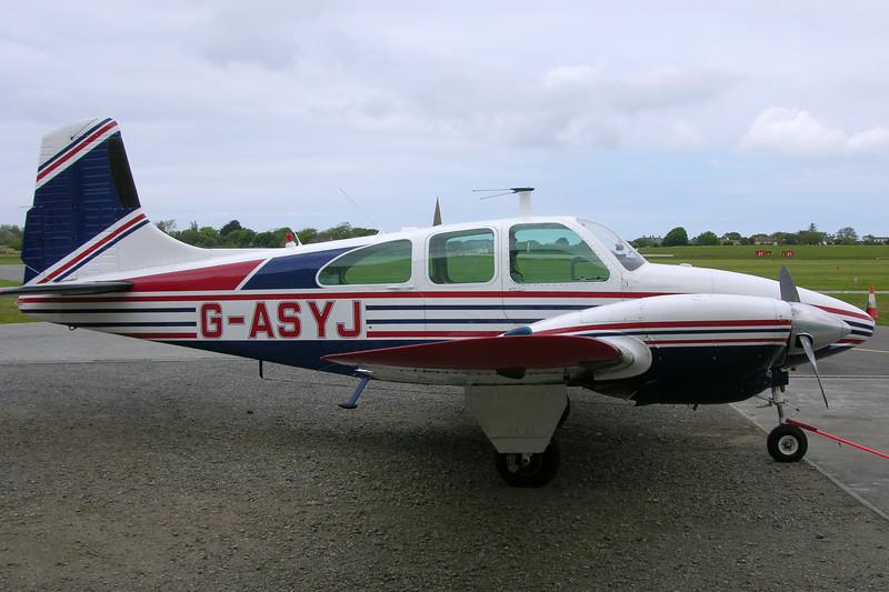 G-ASYJ-BeechD95ATravelAir-Private-EGJJ-2005-05-20-DSCN1008-KBVPCollection.JPG