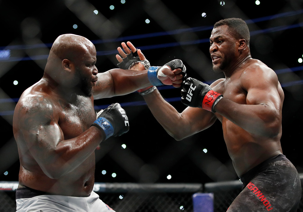 . Francis Ngannou, right, fights Derrick Lewis during a heavyweight mixed martial arts bout at UFC 226, Saturday, July 7, 2018, in Las Vegas. (AP Photo/John Locher)