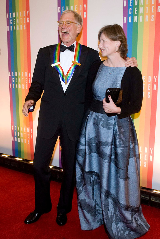 . 2012 Kennedy Center Honoree David Letterman, and his wife, Regina, arrive at the Kennedy Center for the Performing Arts for the 2012 Kennedy Center Honors Performance and Gala Sunday, Dec. 2, 2012 at the State Department in Washington. (AP Photo/Kevin Wolf)