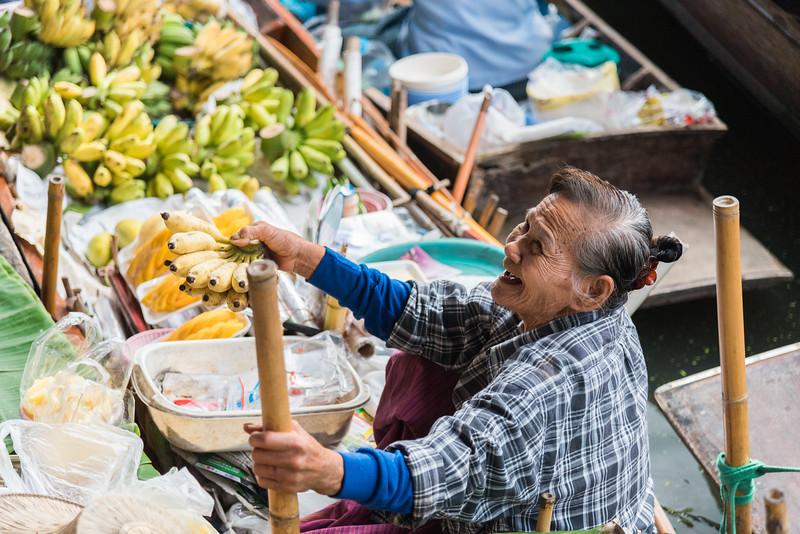 Dec 2017 -  A Lady selling bananas at The Damnoen Saduak Floating River Market, Bangkok, Thailand