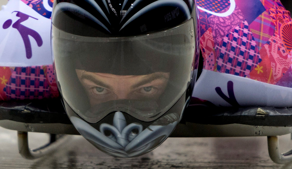 . Ben Sandford, of New Zealand, races down the track at the Sanki Sliding Centre during the men\'s skeleton competition at the 2014 Sochi Winter Olympics in Krasnaya Polyana, Russia, Saturday, Feb. 15, 2014. (AP Photo/The Canadian Press, Jonathan Hayward)