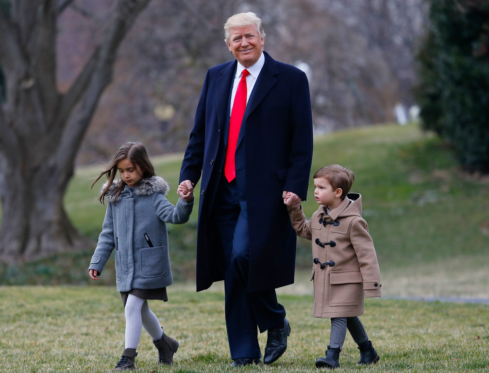 . President Donald Trump walks with his grandchildren Arabella Kushner and Joseph Kushner to Marine One on the South Lawn of the White House in Washington, Friday, Feb. 17, 2017, for a short trip to Andrews Air Force Base, Md., then onto South Carolina and Florida. (AP Photo/Pablo Martinez Monsivais)