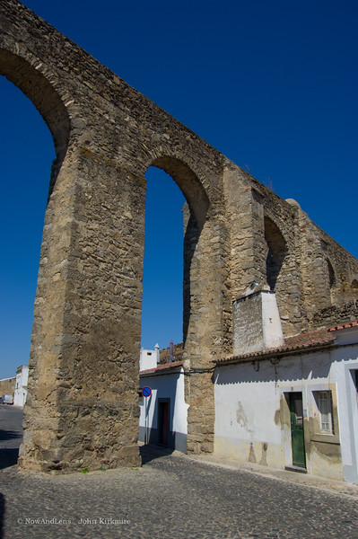 Aquaduct and house, Evora, Portugal