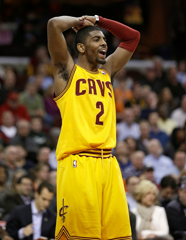 . Cleveland Cavaliers\' Kyrie Irving reacts during an NBA basketball game against the New York Knicks Monday, March 4, 2013, in Cleveland. (AP Photo/Tony Dejak)