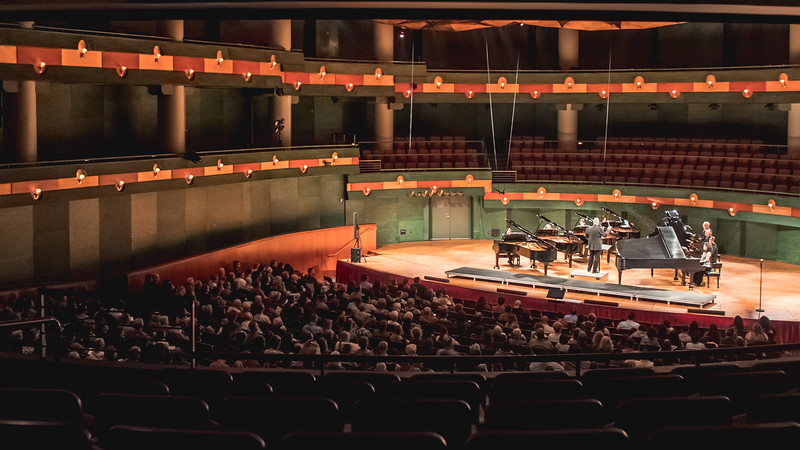 Eight Grand Pianos take up the stage at the Performing Arts Center for the Monster Concert performance during Piano Week.