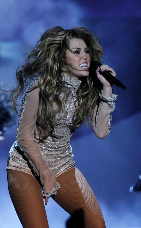 . Singer Miley Cyrus performs at the MTV European Music Awards 2010, in Madrid, Sunday, Nov. 7, 2010. (AP Photo/Joel Ryan)