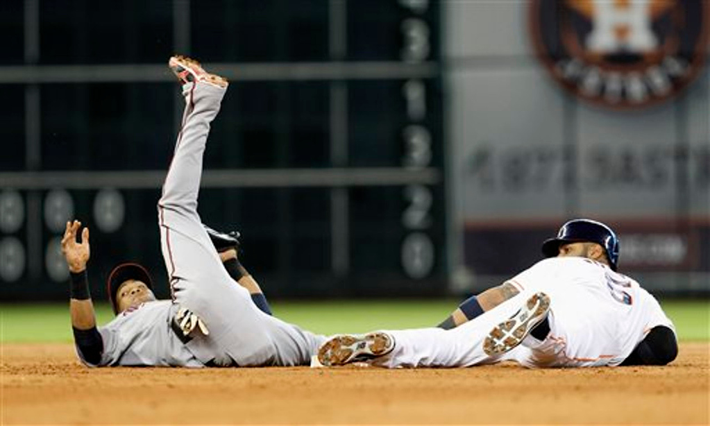 . Houston Astros\' Jonathan Villar  is tagged out by Minnesota Twins shortstop Pedro Florimon attempting to steal second base in the eighth. (AP Photo/Bob Levey)