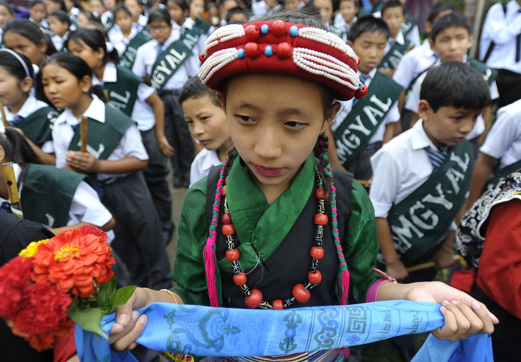 . Exiled Tibetans watch during an event honouring the 78th birthday of their spiritual leader, The Dalai Lama at Manag monastry in Kathmandu on July 6, 2013.  Thousands of Tibetans gathered to mark the Dalai Lama\'s 78th birthday on July 6, with the Nepalese government saying it would not tolerate anti-China activities on its soil.  PRAKASH MATHEMA/AFP/Getty Images