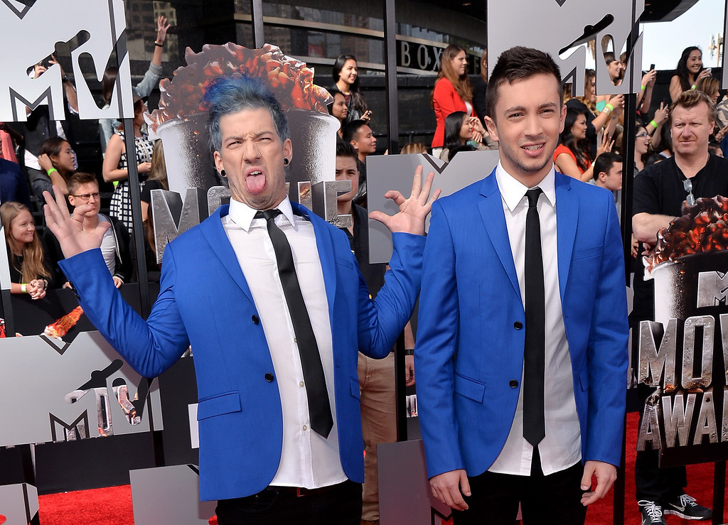 . Musicians Josh Dun (L) and Tyler Joseph of Twenty One Pilots attend the 2014 MTV Movie Awards at Nokia Theatre L.A. Live on April 13, 2014 in Los Angeles, California.  (Photo by Michael Buckner/Getty Images)