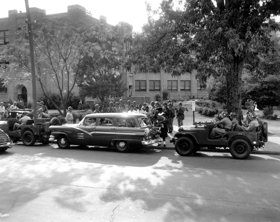 . Federal troops escort black students as they enter Central High School in Little Rock, Ark., during the first week of student integration in Sept. 1957.  (AP Photo)