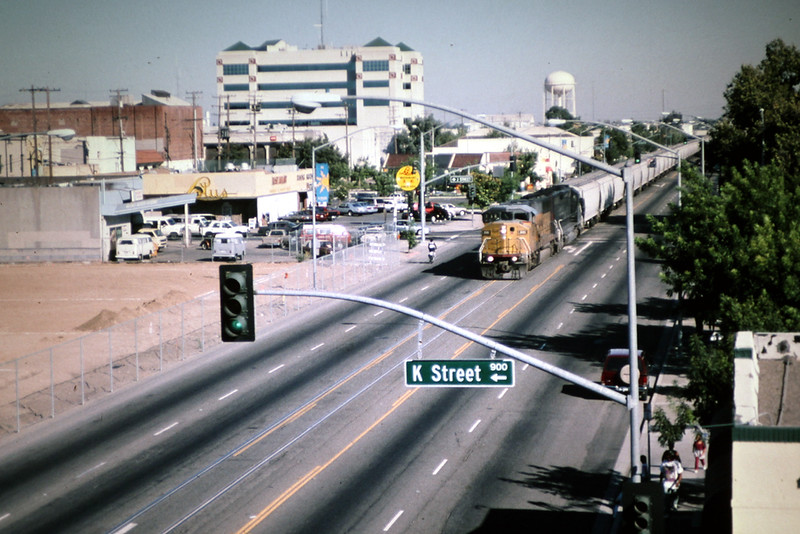 19980727_UP6161_w_NB_grain_train_streetrunning_9th_St_Modesto_CA.jpg