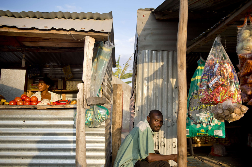 . Two shopkeepers tend to their businesses as the suns sets on July 9, 2013 in the Nkaneng shantytown next to the platinum mine, run by British company Lonmin, in Marikana. On August 16, 2012, police at the Marikana mine open fire on striking workers, killing 34 and injuring 78, during a strike was for better wages and living conditions. Miners still live in dire conditions despite a small wage increase.  ODD ANDERSEN/AFP/Getty Images