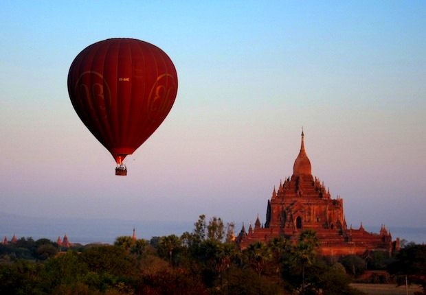 Balloon rising over Htilminlo Paho at dawn in Bagan, Burma.