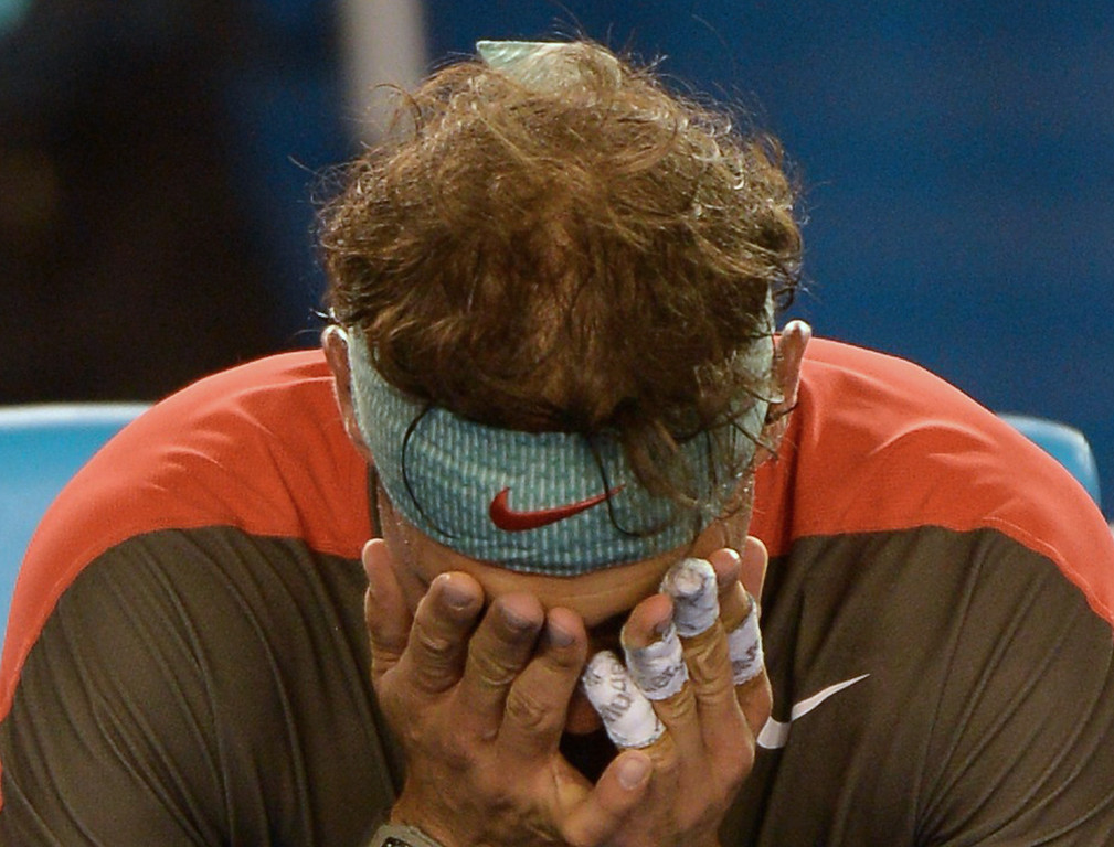 . Spain\'s Rafael Nadal reacts during his mens singles final match against Switzerland\'s Stanislas Wawrinka on day fourteen of the 2014 Australian Open tennis tournament in Melbourne on January 26, 2014.     GREG WOOD/AFP/Getty Images