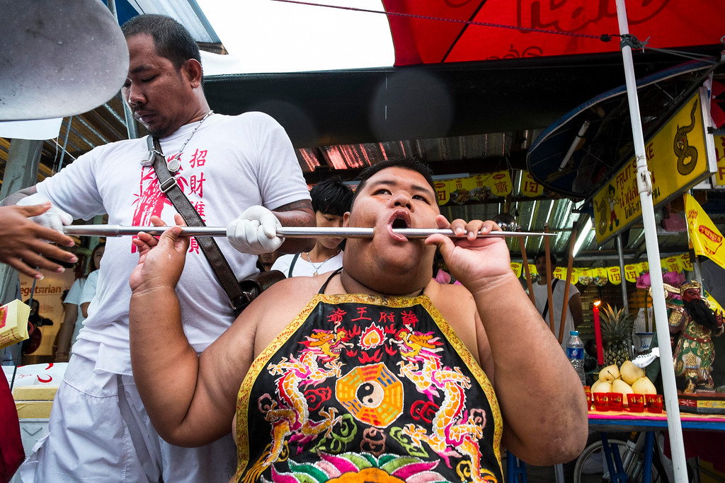 . A devotee has his faced pierced with a steel spike outside Jui Tui Chinese Shrine on September 30, 2014 in Phuket, Thailand. (Photo by David Longstreath/Getty Images)