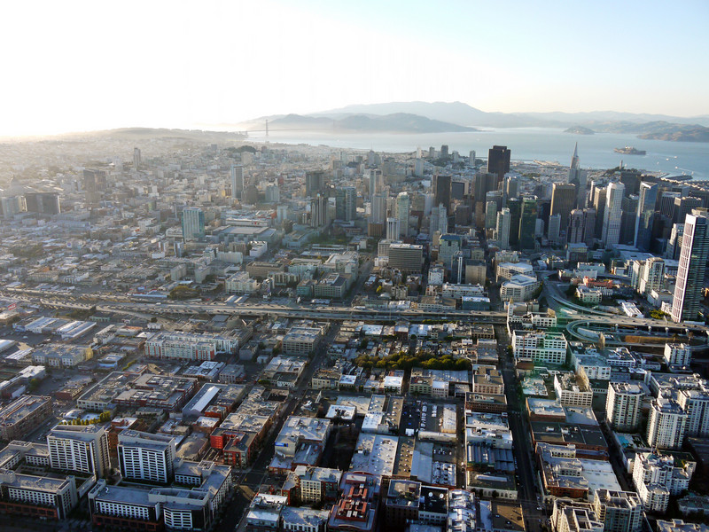 Downtown San Francisco with the Golden Gate bridge in the background, left.