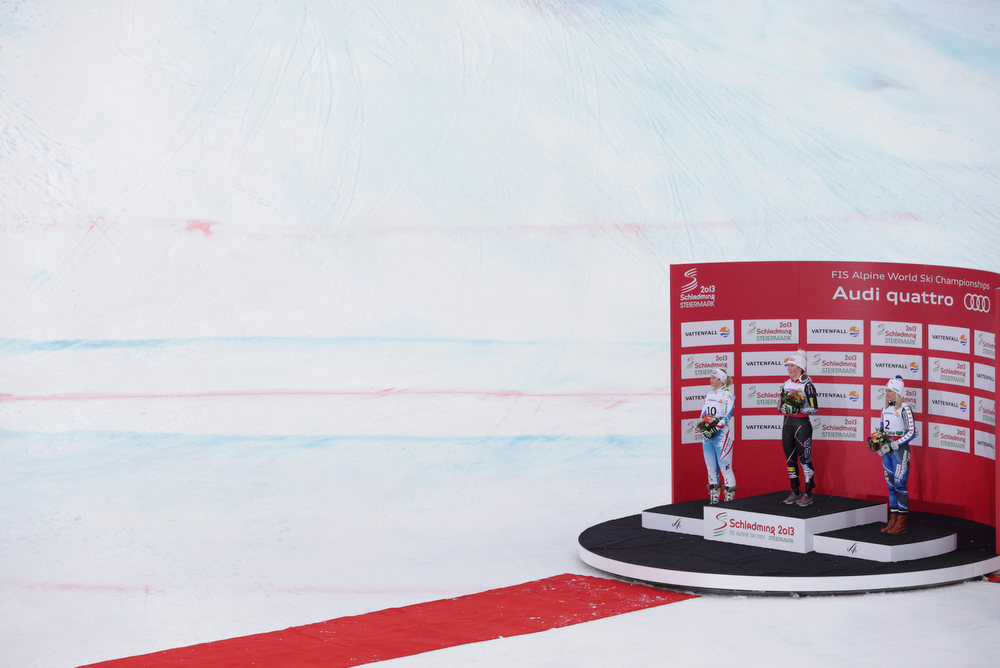 Description of . United States' gold medal winner Mikaela†Shiffrin is flanked by Austria's†silver medal winner Michaela†Kirchgasser, left, and Sweden's†bronze medalist Frida†Hansdotter after the women's slalom at the Alpine skiing world championships in Schladming, Austria, Saturday, Feb.16, 2013. (AP Photo/Matthias Schrader)