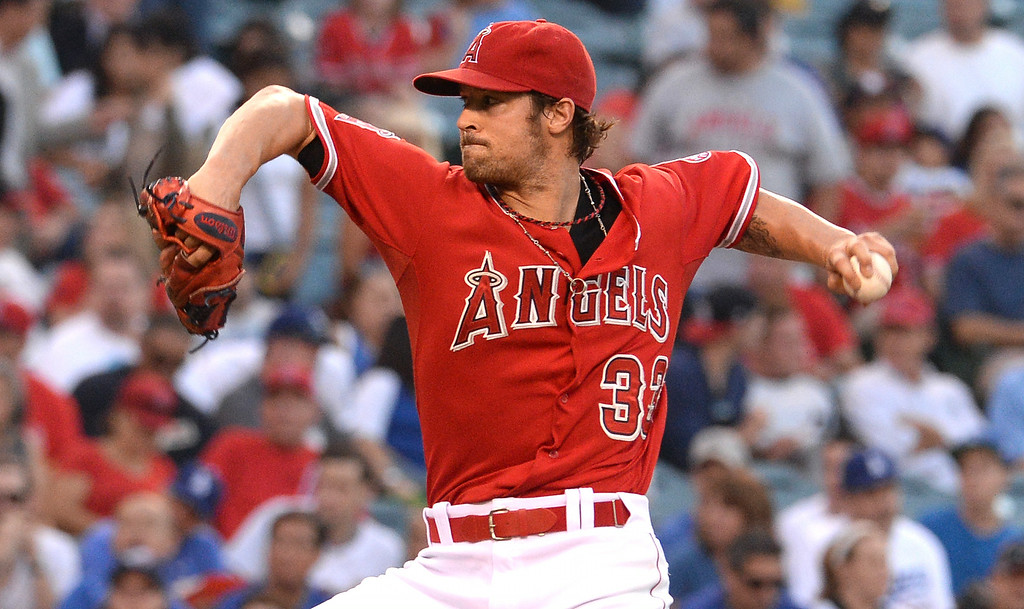 . Los Angeles Angels starting pitcher C.J. Wilson throws to the plate against the Los Angeles Dodgers in the first inning of a baseball game at Anaheim Stadium in Anaheim, Calif., on Thursday, Aug. 7, 2014.  (Photo by Keith Birmingham/ Pasadena Star-News)