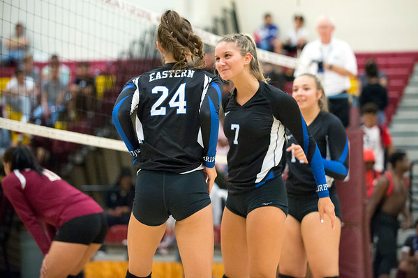 09/16/19 Wesley Bunnell | StaffrrBristol Eastern's Zoe Lowe (7) smiles as Sage Scarritt (24) enters against New Britain during a game on Monday night at New Britain High School.