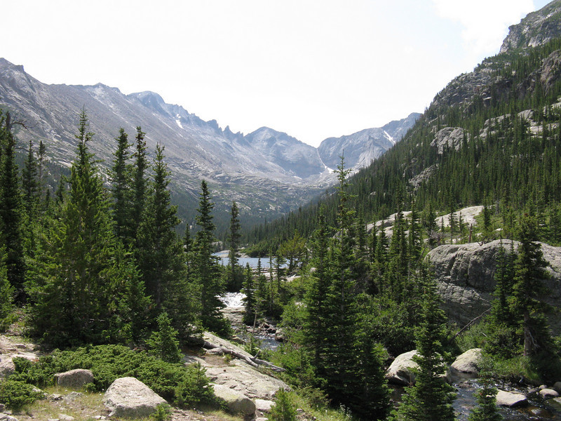 Mills Lake ahead; Longs Peak is prominent bump on left, Pagoda straight ahead - with Keyboard of the Winds ridge running between them.