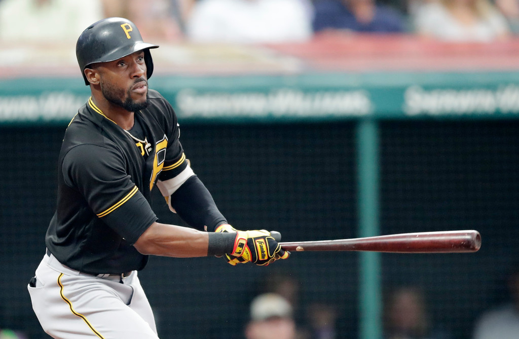 . Pittsburgh Pirates\' Starling Marte watches his ball after hitting an RBI-single off Cleveland Indians starting pitcher Corey Kluber in the second inning of a baseball game, Monday, July 23, 2018, in Cleveland. Jordy Mercer scored on the play. (AP Photo/Tony Dejak)