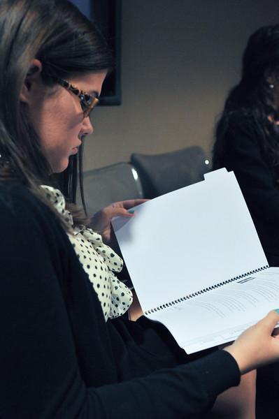 Allison Drenan looks over TWC materials