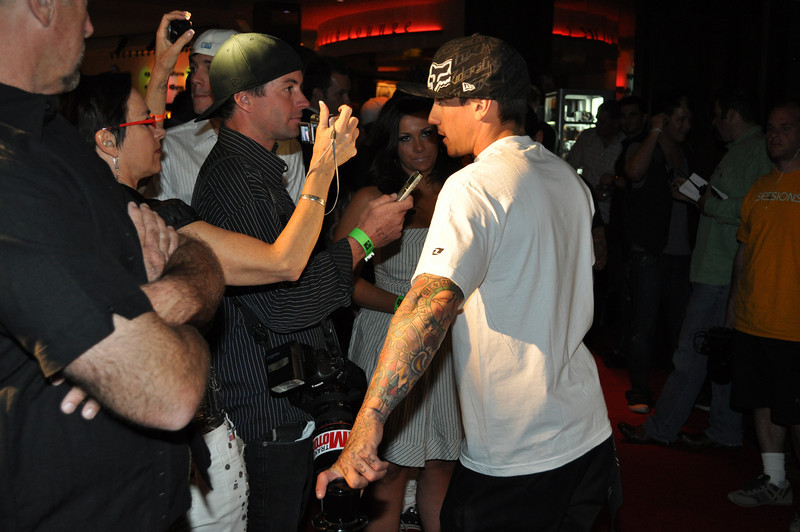 """DOWNLOAD PHOTOS FREE * Courtesy of """"IS Vodka"""" *  www.ISVodka.comMotocross freestyle racer and Gravity Games Champion, Carey Hart, inventor of the """"Hart Breaker"""" and """"Superman Seat Grab"""" has his own rock and roll club """"Wasted Space"""" inside of Hard Rock Casino. Carey Hart also has a new tatoo palor Hart and Huntington inside Hard Rock Casino. Check out the big bore Carey Hart racing Honda motocross bikes in Hard Rock Lobby."""