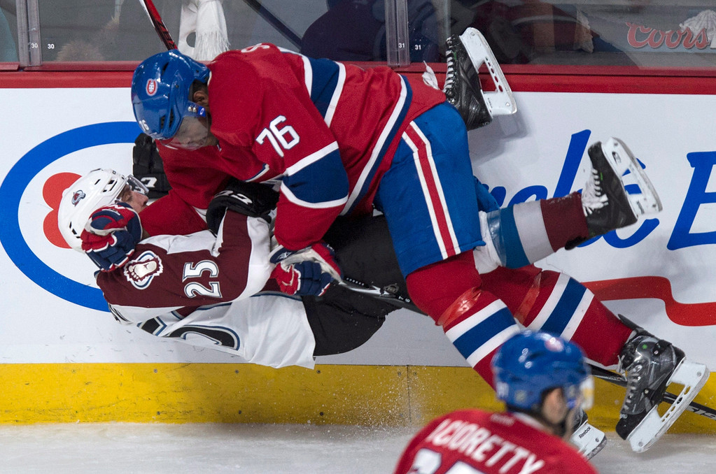 . Colorado Avalanche\'s Maxime Talbot is leveled by Montreal Canadiens\' P.K. Subban during second period NHL hockey action Tuesday, March 18, 2014 in Montreal.  (AP Photo/The Canadian Press, Paul Chiasson)