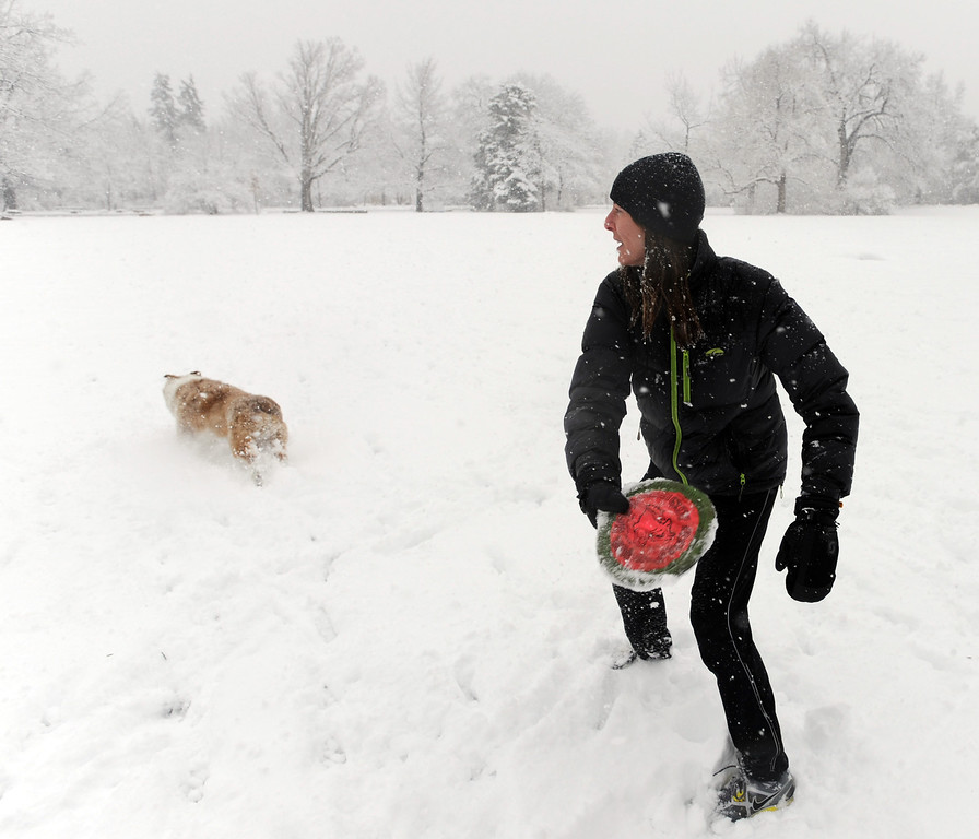 . Laura Rice plays in the snow with her dog, Tussin, at Chautauqua Park in Boulder, Colo, on May 1, 2013.  (AP Photo/The Daily Camera, )  Cliff Grassmick