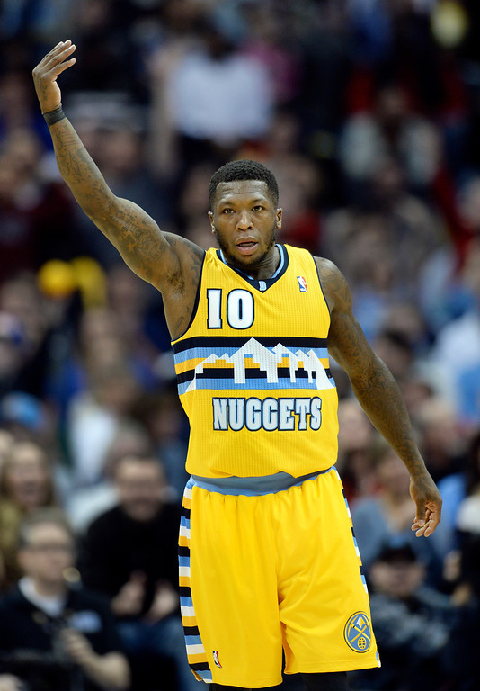 . DENVER, CO. - JANUARY 03:  Denver guard Nate Robinson encouraged the crowd after he hit a three-pointer in the second half. The Denver Nuggets broke an eight-game losing streak with a 111-108 win over the Memphis Grizzlies at the Pepsi Center Friday night, January 3, 2014. Photo By Karl Gehring/The Denver Post