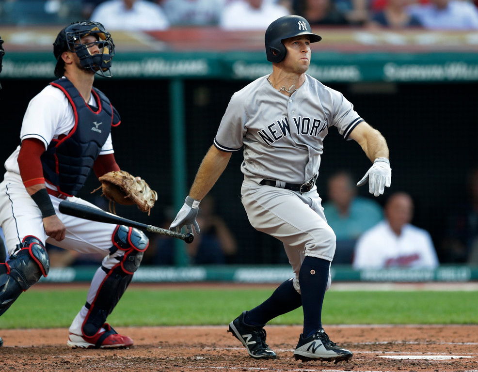 . New York Yankees\' Brett Gardner watches his two-run home run off Cleveland Indians starting pitcher Corey Kluber during the third inning of a baseball game Thursday, July 12, 2018, in Cleveland. Indians catcher Yan Gomes is at left. (AP Photo/Tony Dejak)
