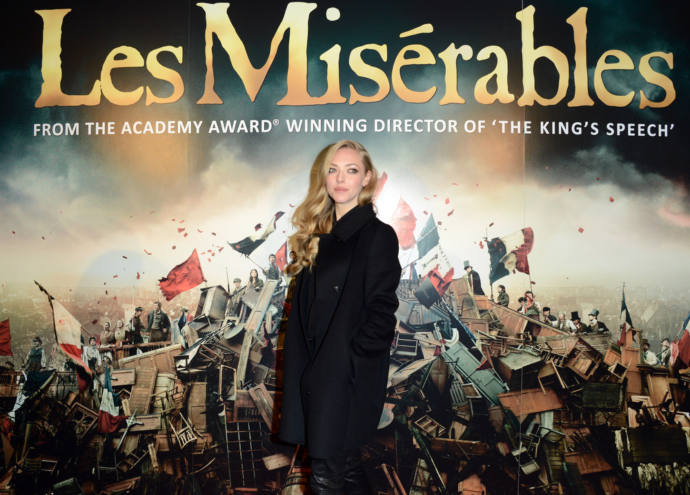Description of . Amanda Seyfried poses for a photograph as she arrives at the after party for the premiere of Les Miserables at the Roundhouse, London, Wednesday, Dec. 5, 2012. (Photo by Jon Furniss/Invision/AP)