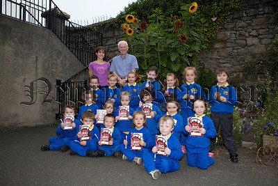 Pictured are Primary 1 and 2 pupils from Bunscoil an Luir who have joined the Toothbrush club. R1439003