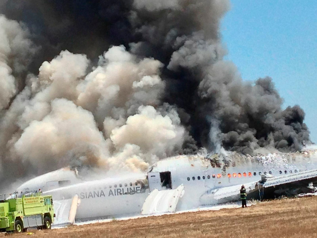 . Asiana Airlines Boeing 777 is engulfed on the tarmac after crash landing at San Francisco International Airport in San Francisco, Calif., on July 6, 2013. (Eugene Anthony Rah via Reuters)i