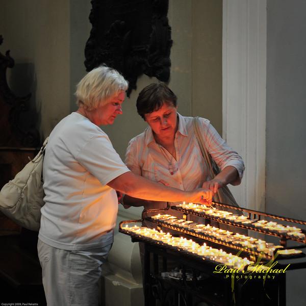 Lighting candles in Katedra.