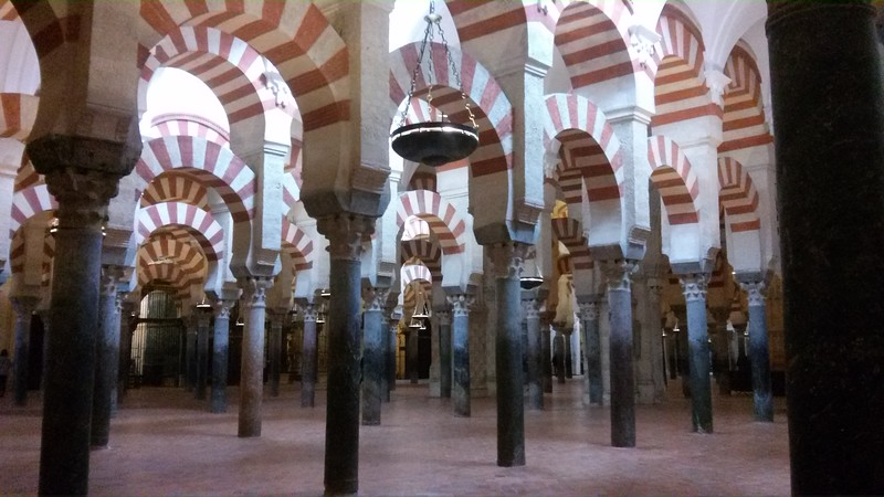 Red and white arches inside Cordoba's mezquita