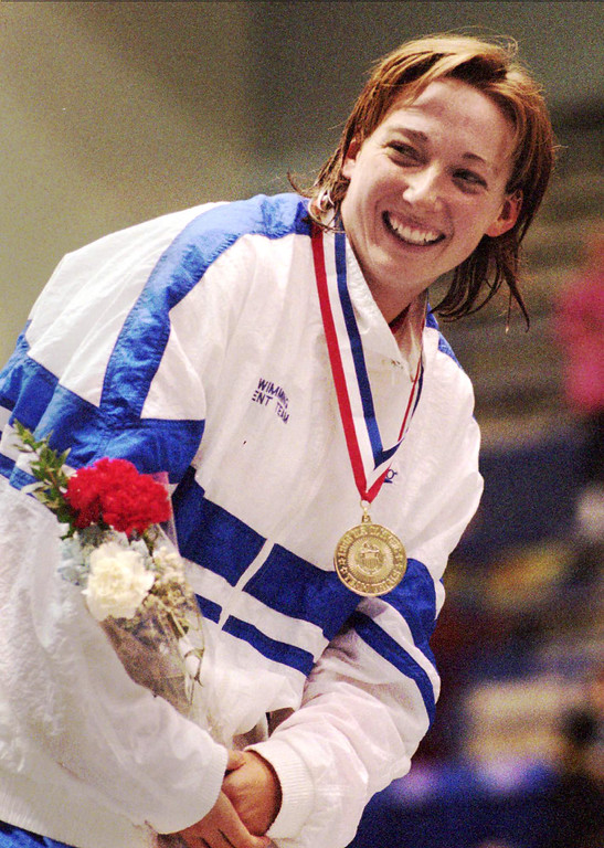 . Amy Van Dyken of breaks into a smile during the medals ceremony after winning the 200-meter butterfly Tuesday, March 12, 1996, at the U.S. Olympic Swim Trials in Indianapolis. (AP Photo/Tom Strickland)